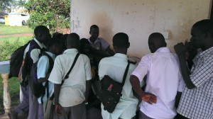 Gulu youth gather around a UNICEF Digital Drum